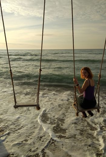 Smiling Water Sea Full Length Beach Women Sitting Young Women Sand Relaxation Swing Outdoor Play Equipment Rope Swing Coast Calm Horizon Over Water Wave Coastline