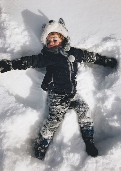 Toddler making snow angels Snow Angel Snow Toddler  Recess Winter Break  Winter Cold Temperature Snow One Person Child Real People Moments Of Happiness Warm Clothing Outdoors Enjoyment Nature Childhood