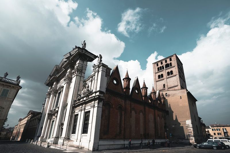 Mantova Built Structure Sky Architecture Building Exterior Cloud - Sky Building Low Angle View Outdoors Sunlight Tall - High Religion Travel Destinations Travel Office Building Exterior Place Of Worship Tourism Nature City Day No People