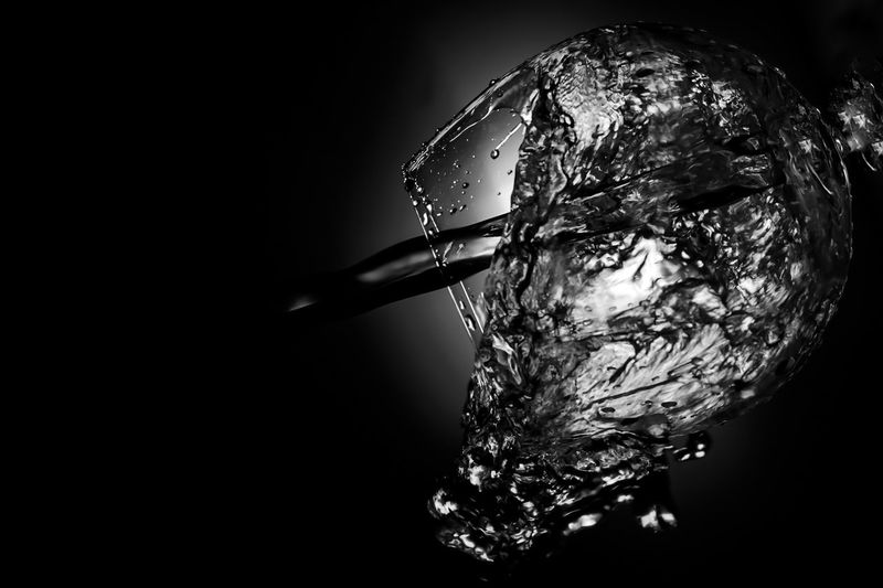 Close-up of water drop against black background