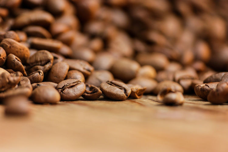 Coffee beans Breakfast Abundance Backgrounds Brown Caffeine Close-up Coffee Coffee - Drink Coffee Bean Drink Food Food And Drink Freshness Indoors  Large Group Of Objects No People Refreshment Roasted Roasted Coffee Bean Selective Focus Still Life Surface Level Table Temptation The Still Life Photographer - 2018 EyeEm Awards