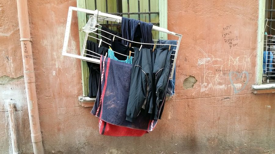 EyeEm Selects Hanging No People Coathanger Building Exterior Architecture Been There. Outdoors Real People Culture And Tradition Houses And Windows Clothes On The Hangers Clothes Peg Clothingline Decoration