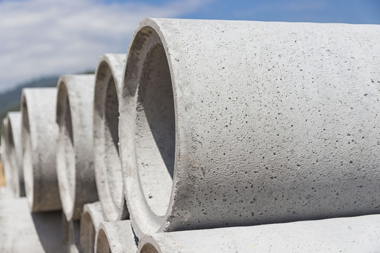 Abundance Alloy Architecture Close-up Concrete Construction Industry Construction Site Day Development Gray In A Row Industry Large Group Of Objects Manhole  Manholes Nature No People Outdoors Pipe - Tube Road Construction Steel Water