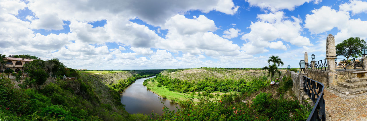 Panorama - Chavon River - Dominican Republic - Caribbean Altos De Chavon Chavon Dominican Republic Anaconda Architecture Beauty In Nature Building Exterior Built Structure Chavon River Cloud - Sky Day Landscape Nature No People Outdoors Panoramic Scenics Sky Travel Destinations Tree Water
