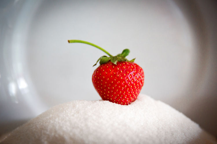 Close-up of strawberries on hand