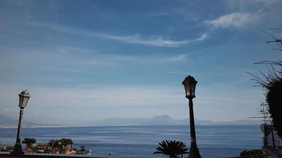 Italia Napoli Travel Beauty In Nature Cloud - Sky Day Italy Landscape Landscape_photography Mountain Napoliphotoproject Nature No People Outdoors Palm Tree Photo Scenics Sea Sky Street Light Tranquil Scene Tranquility Travel Destinations Tree Water EyeEmNewHere