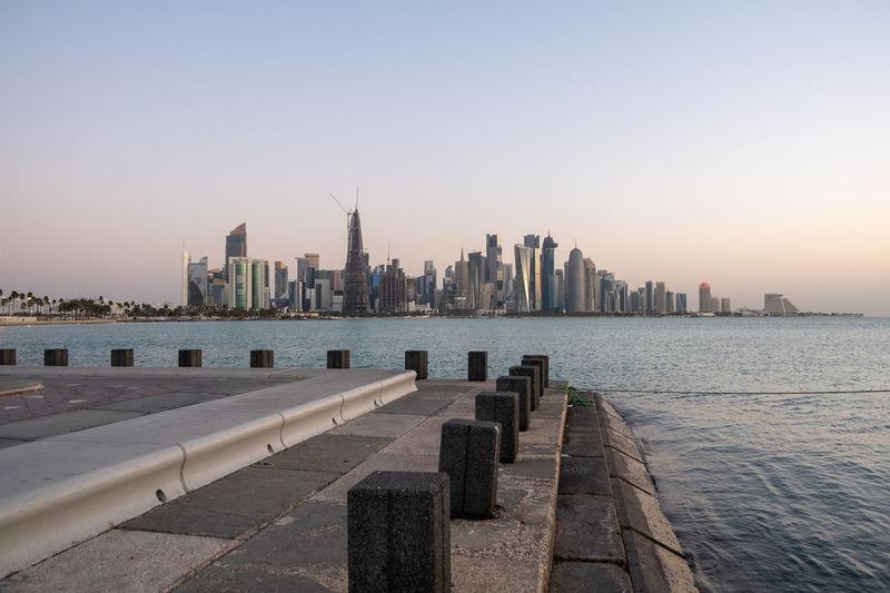 Modern buildings of doha, qatar against clear sky