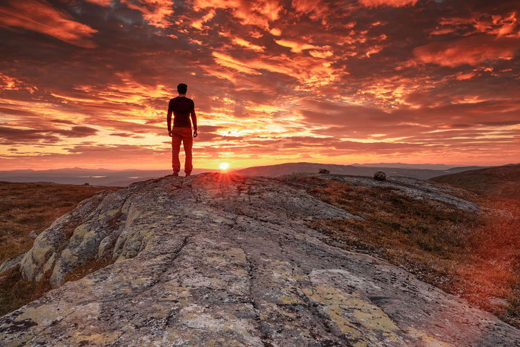 man standing at sunset view point in the mountains Full Length Sunset Men Standing Adventure Desert Arid Climate Sand Dune Beach Sky Hiker Hiking Arid Landscape Horizon Over Water Countryside Explorer Mountain Climbing Pursuit - Concept Silhouette Remote Calm Ocean Hiking Pole Extreme Terrain Shore Trail Backpack Coast