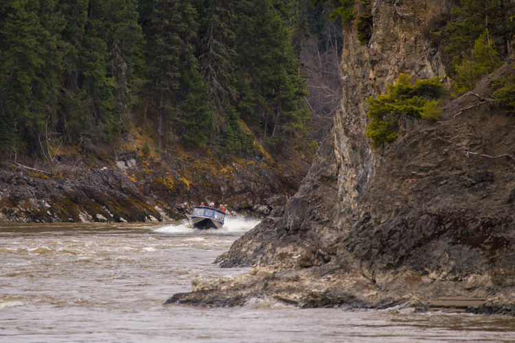 "Another shot from Jet boating in the Fort George Canyon last weekend. Up until the completion of the railway the Fraser River was the main transport route in and out of Fort George (now Prince George), and the Fort George Canyon was one of the key obstacles that sternwheelers had to navigate. It quickly became known for its dangerous reefs, rapids, and whirlpools. Sternwheelers like the ""BX"", ""Nechacco"" and ""Quesnel"", navigated these treacherous waters in the early 1900's. The BX sank in Ft George Canyon in November 1919 after striking a rock. It was loaded with 2500 bags of cement that perished. In April 1921, the Quesnel would become the last sternwheeler to run the gauntlet through the canyon. She was relaunched with the intent of resuming the local service abandoned by the BC Express and BX and lasted only three weeks before being wrecked in the canyon. During the salvage of her cargo, which included 100 barrels of beer, she broke free from the rock she was caught on and sank and was never recovered. Fort George Canyon Provincial Park, Northern British Columbia, Canada www.robertdowniephotography.com Love Life, Love Photography Adventure Boat British Canada Canyon Cliff Cliffs Columbia Fort Fraser George Jet Mountain Nature Northern One Man Only One Person Outdoors Prince  Rapids River Rock Sternwheelers Trees Water"