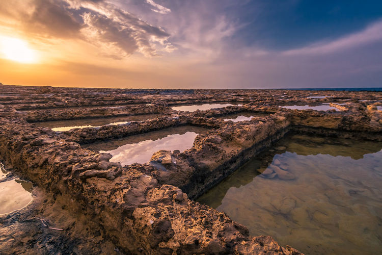 Beauty In Nature Cloud - Sky Gozo Malta Horizon Over Water Idyllic Landscape Nature No People Outdoors Rock Formation Salt - Mineral Salt Basin Salt Flat Salzbecken Scenics Sea Sky Sunlight Sunset Tranquil Scene Tranquility Water