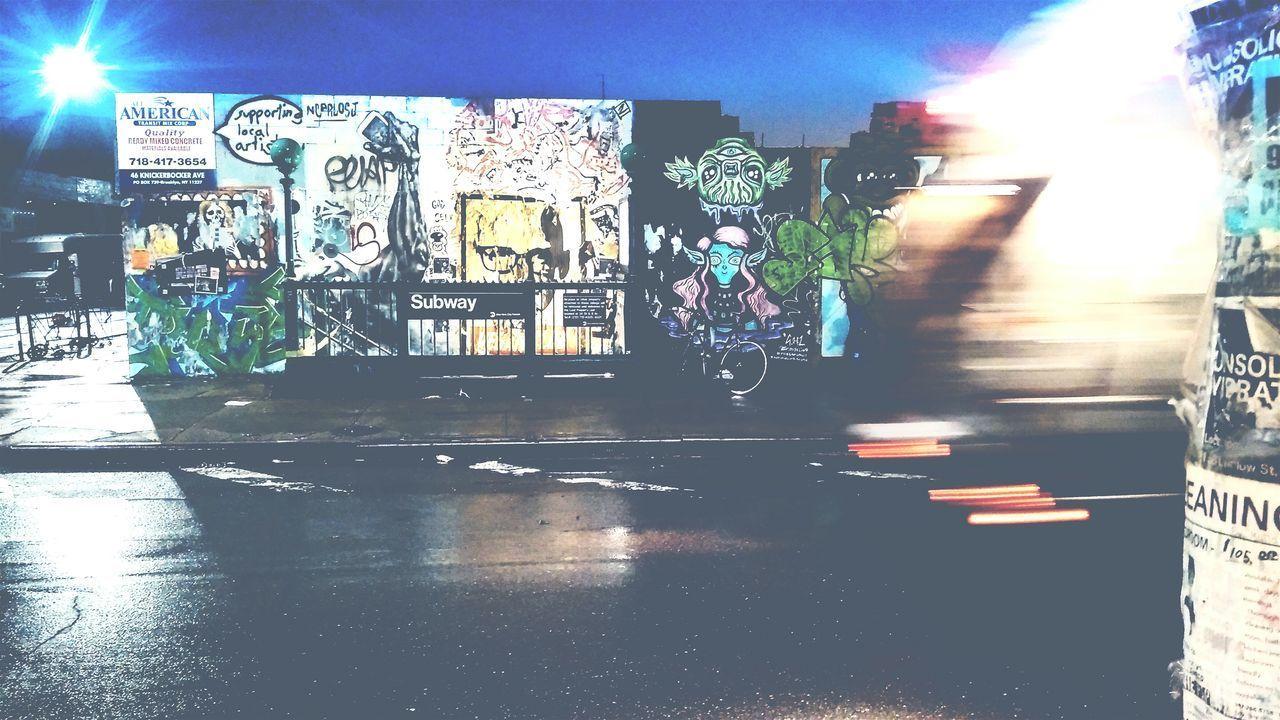 BLURRED MOTION OF ILLUMINATED STREET