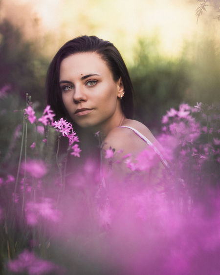 Zenity Portrait Young Adult One Person Flowering Plant Plant Young Women Flower Women Looking At Camera Beautiful Woman Beauty Lifestyles Adult Leisure Activity Real People Front View Selective Focus Pink Color Outdoors Purple Contemplation Hairstyle