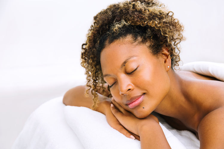 Close-up of young woman sleeping on bed