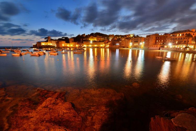 Illuminated Sestri Levante By Sea Against Sky At Dusk