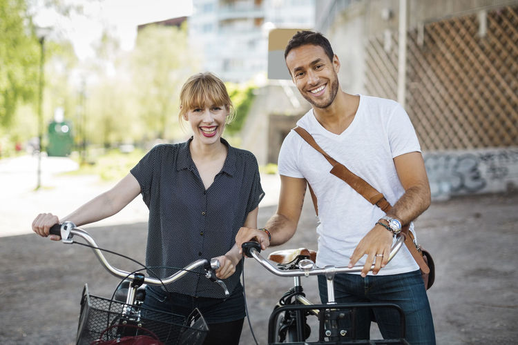 Smiling young man with bicycle