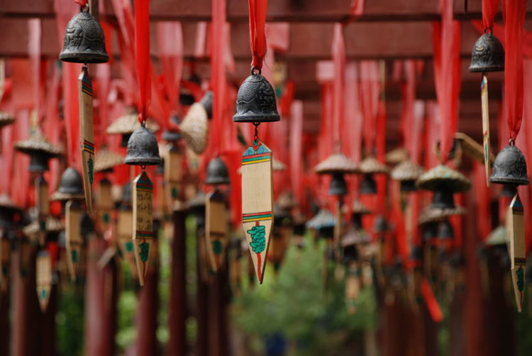 Close-up of wind chimes hanging outdoors