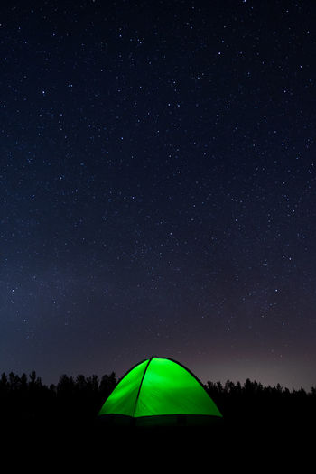 Low angle view of tent against sky at night