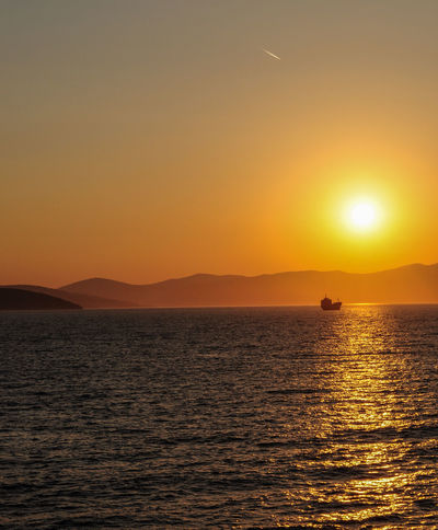 Beauty In Nature Day Idyllic Nature No People Outdoors Scenics Sea Shadow Sky Sun Sunlight Sunset Sunset Silhouettes Sunset_collection Tranquil Scene Tranquility Water Waterfront Wave