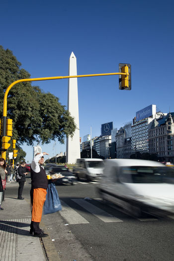 9dejulio Architecture Blue Buenosaires Built Structure City City Life City Street Cityscape Clear Sky Day Fast Cars Lifestyles Obelisco, Buenos Aires 🌆 Outdoors Road Road Sign Sky The Way Forward Tourism Tourist Attraction