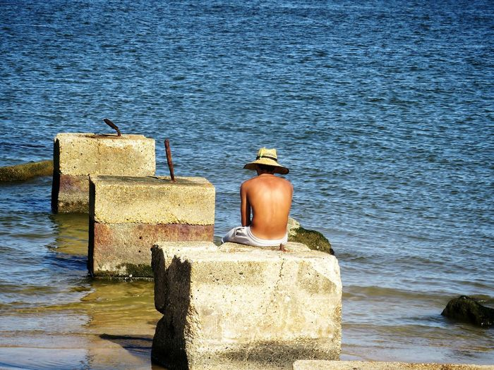 Contemplating life... Alone Time One Man Only In Thought Water Sea Built Structure Waterfront Shore Mid Distance Sandy Beach Wake - Water Ocean Surf