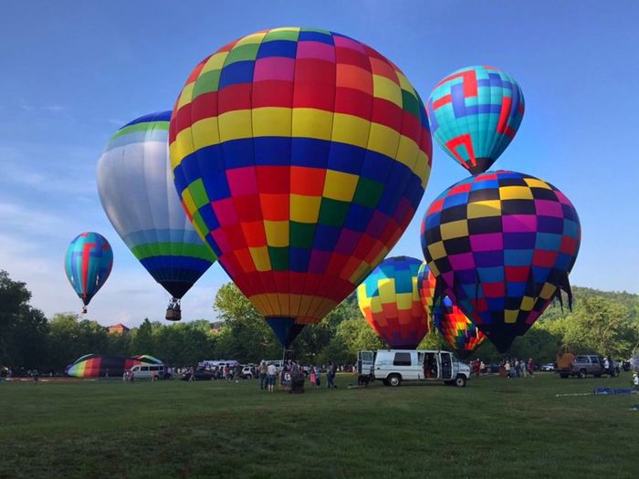 Multi Colored Hot Air Balloon Flying In Blue Sky