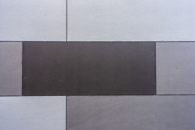 Brown gray background, wall of a house Brown Gray Backgrounds Wall - Building Feature Full Frame Architecture Built Structure Pattern Gray No People Day Geometric Shape Building Exterior Flooring Close-up Shape Concrete Outdoors Wall Textured  Blank Footpath Rectangle