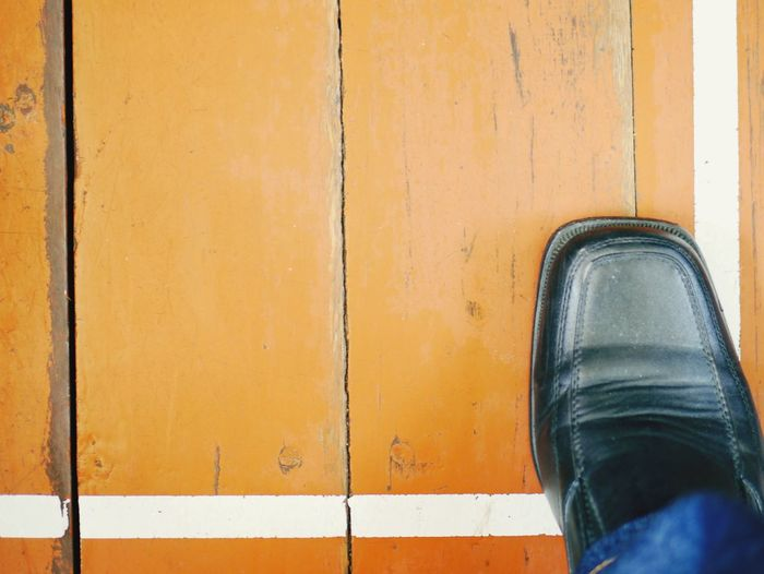 Outdoors Close-up Shoes One Man Only Real People Wood - Material Wooden Texture Background Paint The Town Yellow