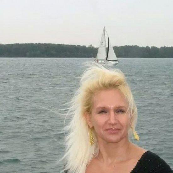 Detroit, Michigan. TheWeekOnEyeEM Sky Outdoors Nikon Summer Detroit, MI Detroit River Lake Lake Michigan Lakelife Waterfront Woman Portrait Windy Boat Wind Waves, Ocean, Nature Waves Blonde Blonde Hair Travel