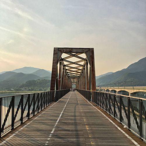Long footbridge against the sky