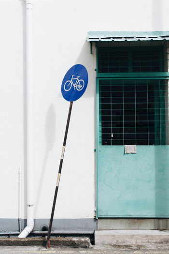 Façade Signage Architecture Blue Sign Building Building Exterior Built Structure Colored Door Communication Day Door Minimal No People Outdoors Road Sign White Wall