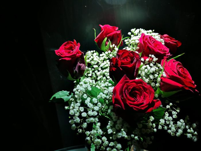 High angle view of rose bouquet against black background