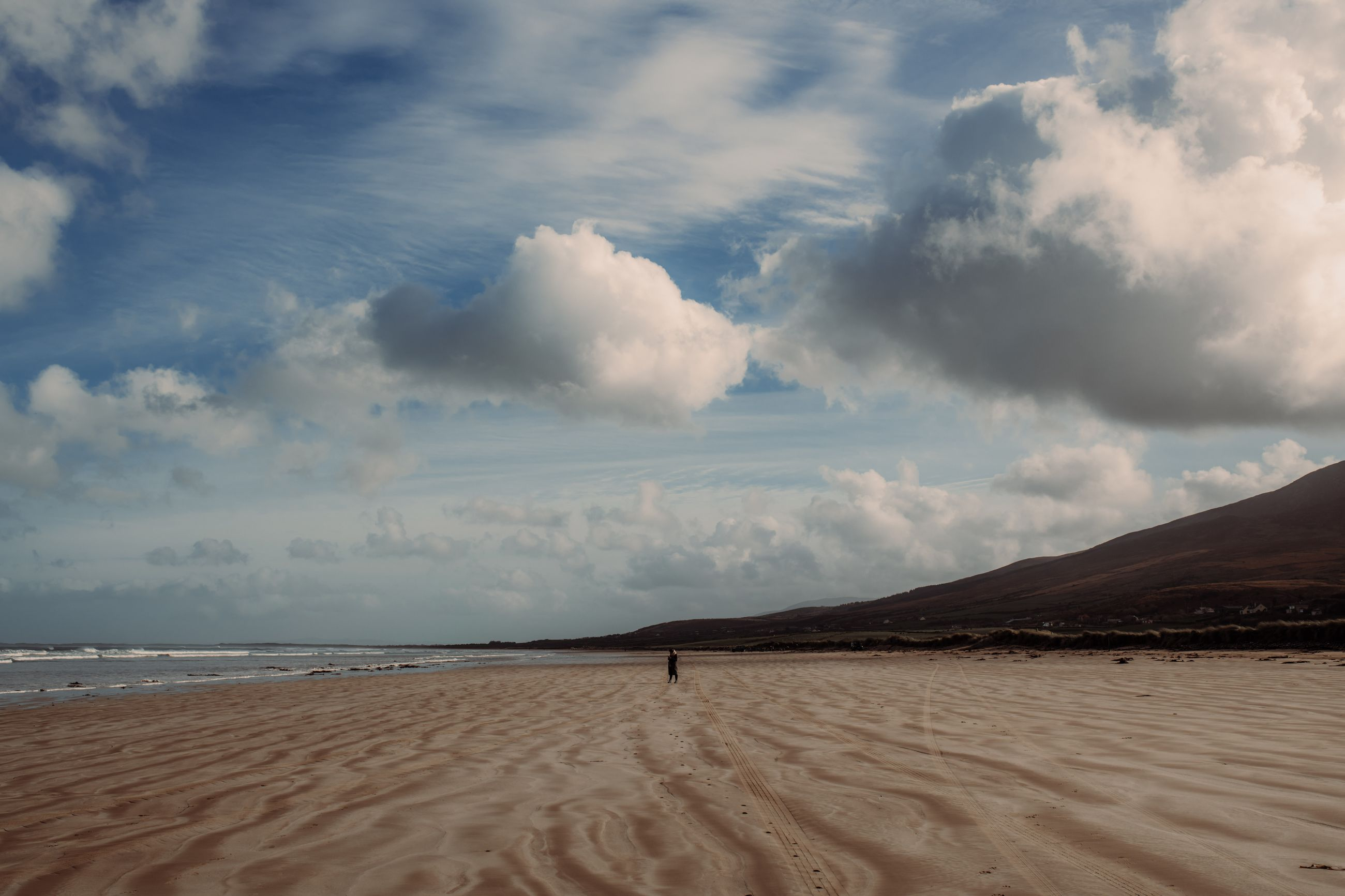 cloud - sky, sky, scenics - nature, beauty in nature, land, sand, tranquility, tranquil scene, non-urban scene, beach, nature, water, sea, desert, landscape, environment, no people, day, idyllic, outdoors, climate, arid climate