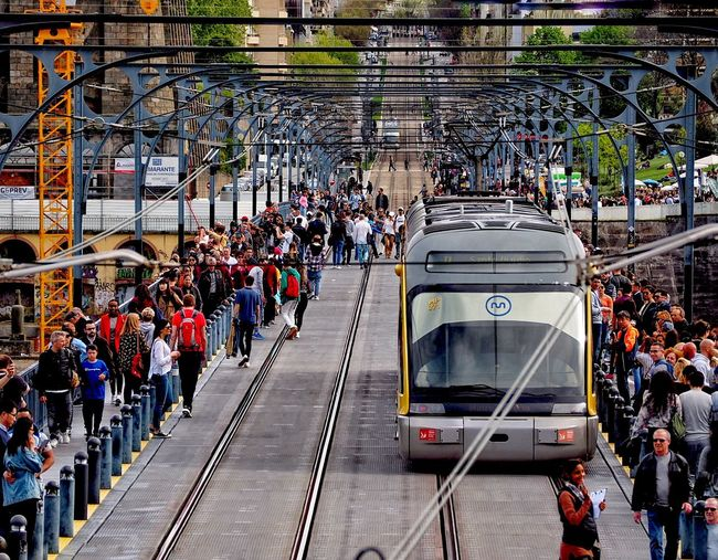 Bridge - Man Made Structure Crowd Large Group Of People Group Of People Real People Transportation Mode Of Transportation Men City Architecture Land Vehicle Public Transportation Day Street High Angle View Lifestyles Outdoors Travel