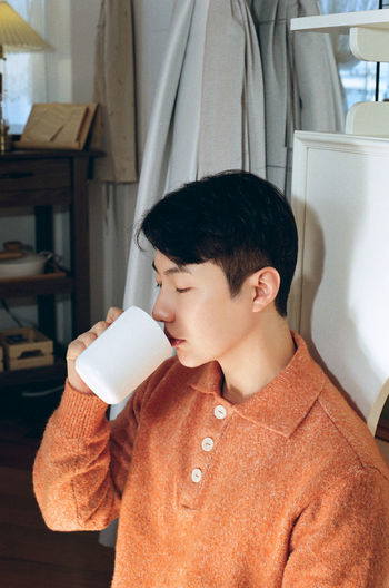 Boy drinking coffee at home