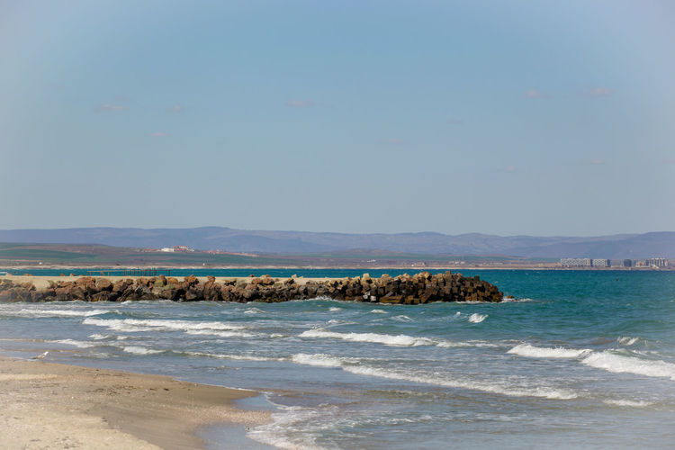 Beautiful View To The Sea Coast In Pomorie, Bulgaria. Water Sea Beach Land Sky Beauty In Nature Scenics - Nature Motion Wave Nature No People Day Tranquil Scene Mountain Aquatic Sport Tranquility Outdoors Sport