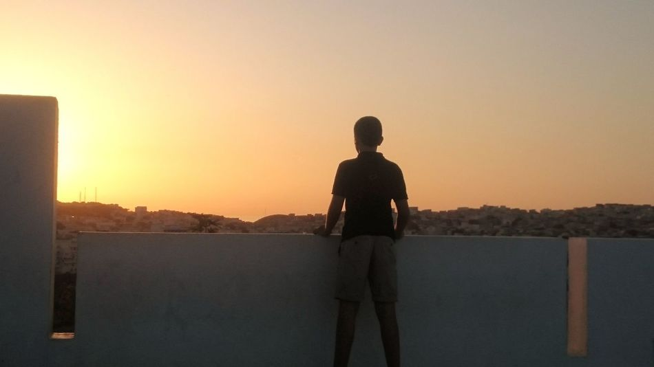 Live For The Story One Person Sunset Outdoors People Sky Clear Sky Nature Young Adult Standing Boy Morrocco Morrocan One Man Only Full Length Men One Young Man Only Water Day Politics And Government