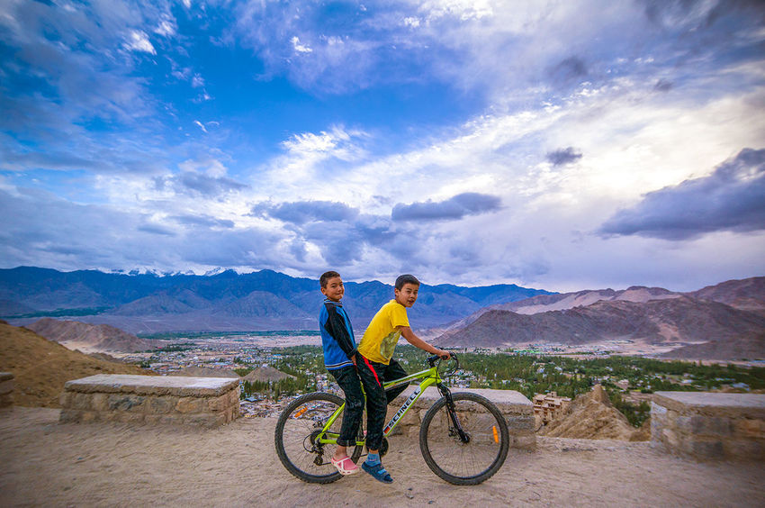 portrait of Junaid and Saim riding their bike to the Tsemo Monastary in Ladakh Kashmir India... height was 4000 metres i had trouble with breathing from altitude sickness, these boys having grown up in the area showed no signs at all Landscape Traveling Nature Candid On Your Bike