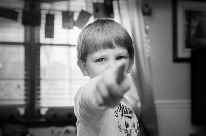My nephew likes to cause trouble... Shot with a Nikon f4 and 50mm 1.8 lens, on ilford hp5. Filmisnotdead Blackandwhite Ilford Film Photography Nikonphotography First Eyeem Photo The Portraitist - 2016 EyeEm Awards
