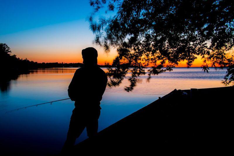 People fishing at coastline