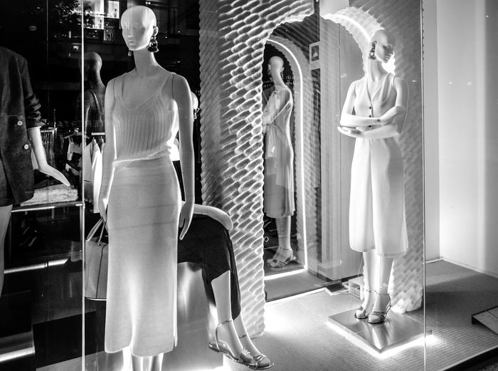 Rear view of women standing in store