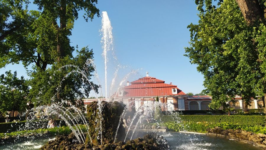Fountain in park against buildings
