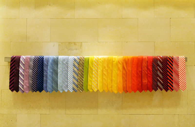 Various neckties hanging on rack in store