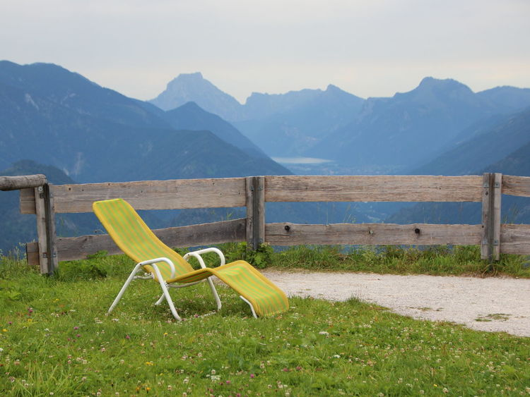 On the top of the Austrian Alps Travel Alps Beauty In Nature Chair Day Empty Grass Landscape Mountain Mountain Range Nature No People Outdoors Scenics Silence Sky Sun Chair Sunchair Sunseeker Top Of The Mountains Tranquil Scene Tranquility Vacation Yellow Chair