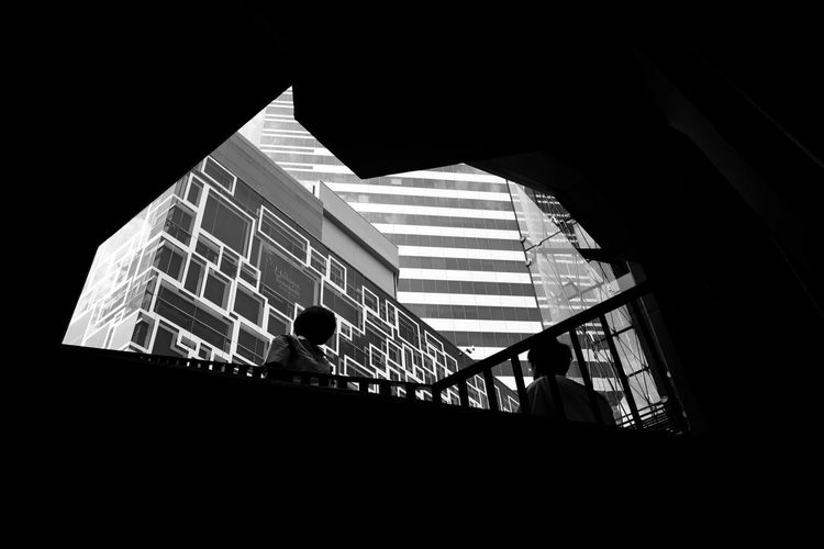 The Art Of Street Photography Architecture Built Structure Building Low Angle View Window Building Exterior Night Silhouette Railing Dark Glass - Material Outdoors Nature Real People Staircase Copy Space Sky