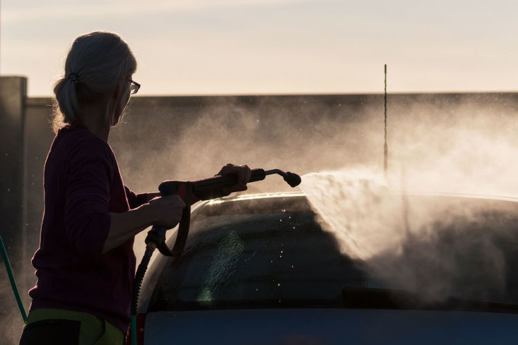 Silhouette Woman Washing Car
