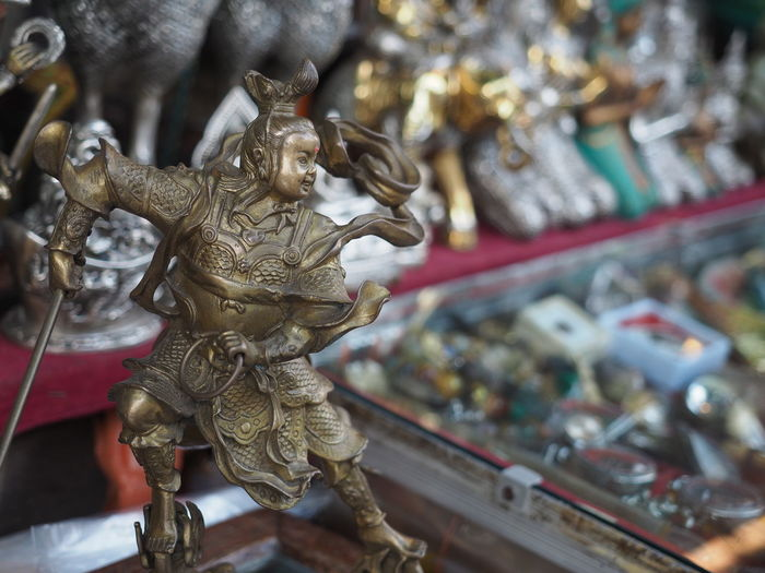 Art And Craft Sculpture Representation Statue Focus On Foreground Close-up Goddess Of Nezha Metal Gold Colored Religion Spirituality Belief