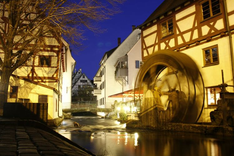 Ulm Fachwerkhaus Streetphotography Tourism Historical Building City Water Cityscape Sculpture Reflection Sky Architecture Building Exterior Built Structure Watermill Light Trail Long Exposure Water Wheel Fountain Clock Tower The Architect - 2018 EyeEm Awards HUAWEI Photo Award: After Dark