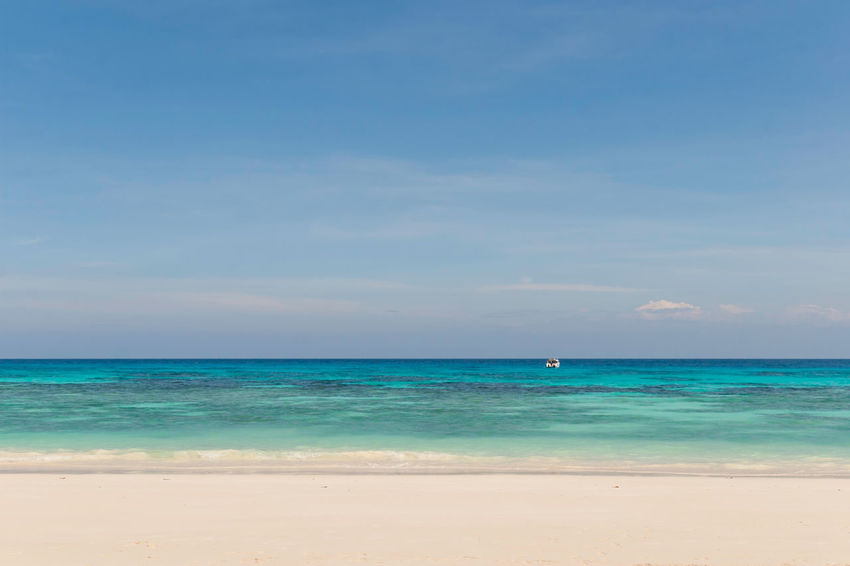 White sand beach on Tachai island with speedboat on background Andaman Sea Beach Beauty In Nature Blue Day Dive Horizon Over Water Nature Ocean Outdoors Sand Scenics Sea Seaside Similan Sky Snorkelling Tachai Tranquil Scene Tranquility Travel Destinations Vacations Water Lost In The Landscape