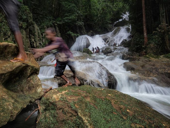 Climb and jump a long the river of water fall Water Tree Spraying Waterfall Motion Men Working Long Exposure Blurred Motion Be Brave