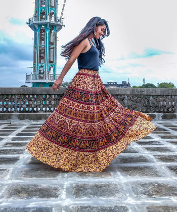 spread happiness Architecture Beautiful Woman Building Exterior Built Structure Casual Clothing Cloud - Sky Day Front View Full Length Leisure Activity Lifestyles One Person Outdoors Portrait Posing Real People Sky Standing Traditional Clothing Travel Destinations Young Adult Young Women